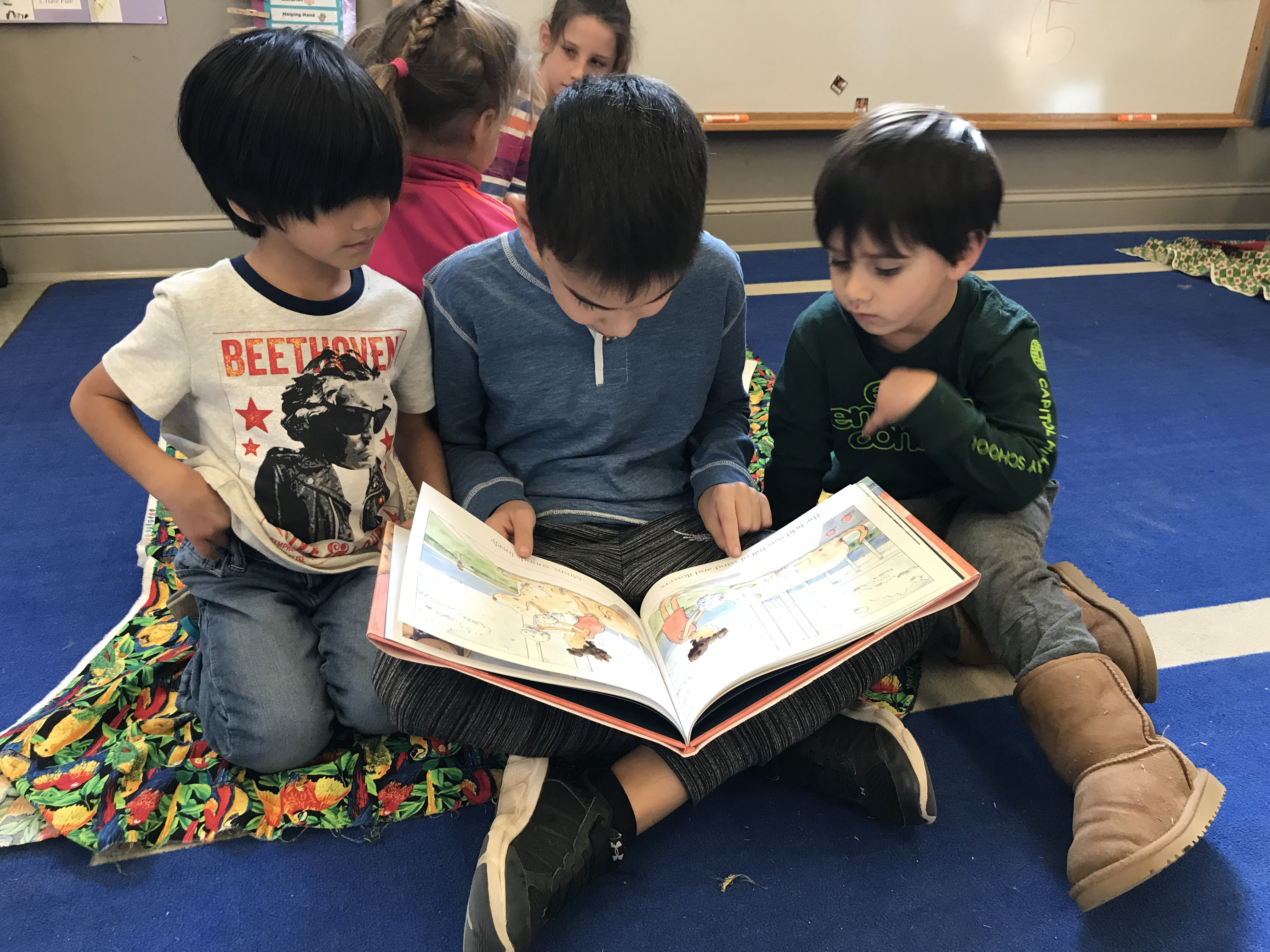 Older students reading to younger students.